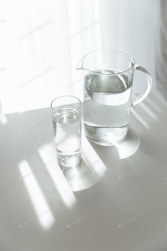 Water jug on white table indoors