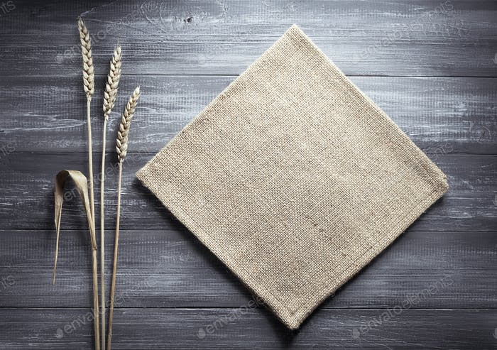ears of wheat and cloth on wood