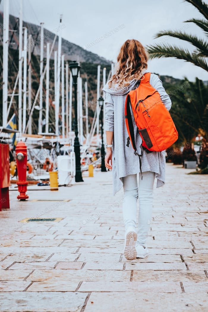Young woman with orange backpack