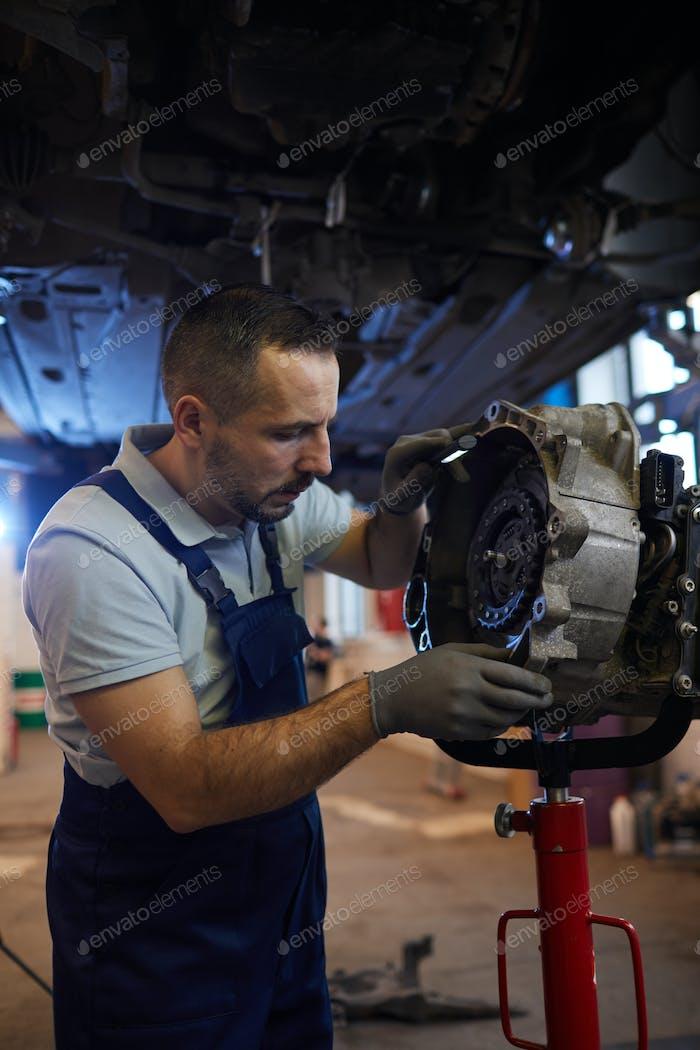 Mechanic Repairing Car on Lift