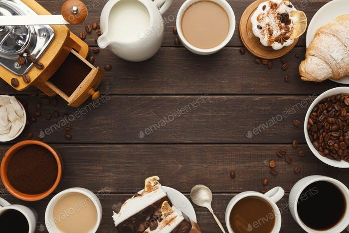 Various coffee cups and sweet pastry on vintage wooden table, to