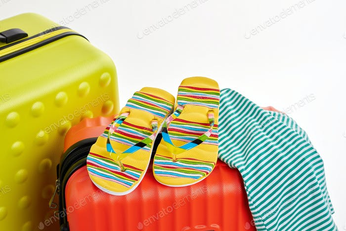 Flips, clothes, suitcases close up