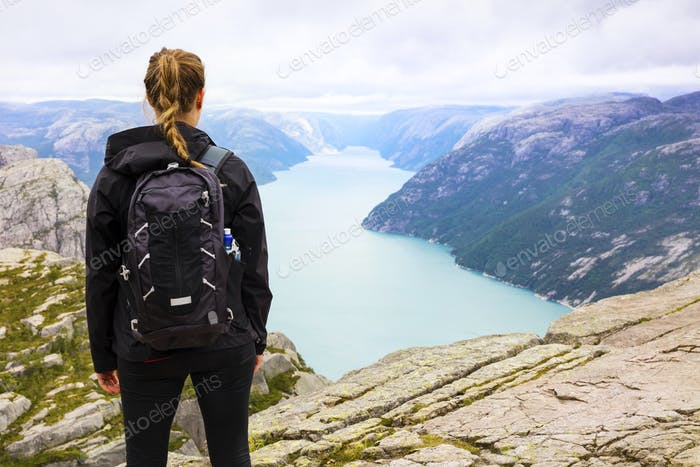 Woman hiking at the Preikestolen cliff in lysefjorden Norway