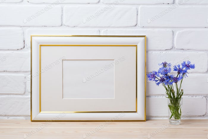 Gold decorated frame mockup with cornflower