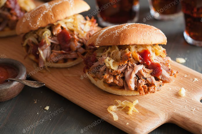 homemade pulled pork burger with caramelized onion and bbq sauce