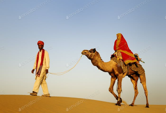 Indigenous Indian Man And Woman Traveling Through The Desert Rid