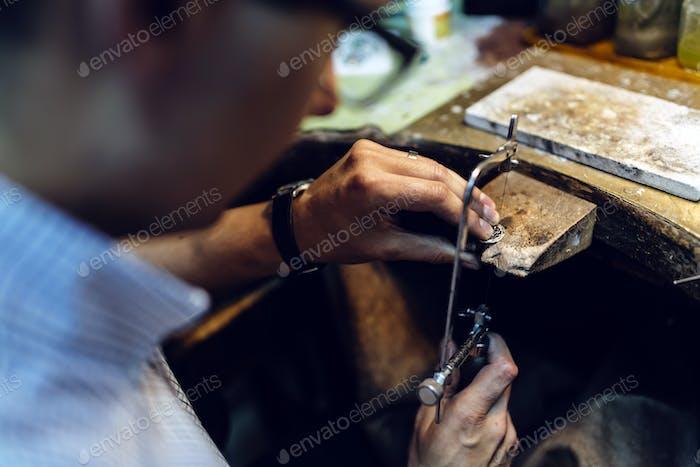 Jeweler making jewelry