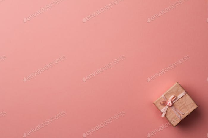 small gift box on pink paper background