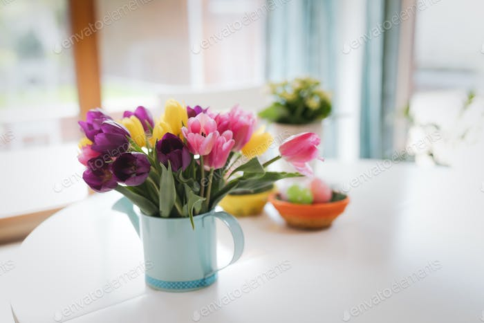 Bunch of spring tulips flowers with easter eggs