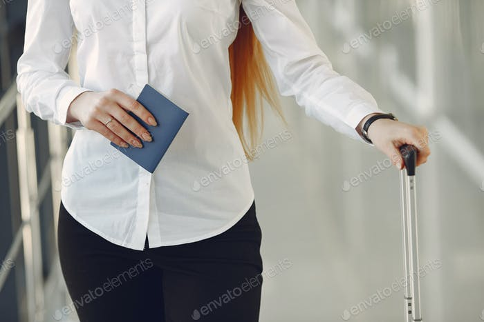 Woman with suitcase at the airport