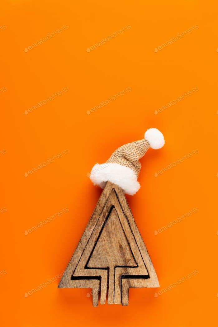 Christmas decorations on orange background.