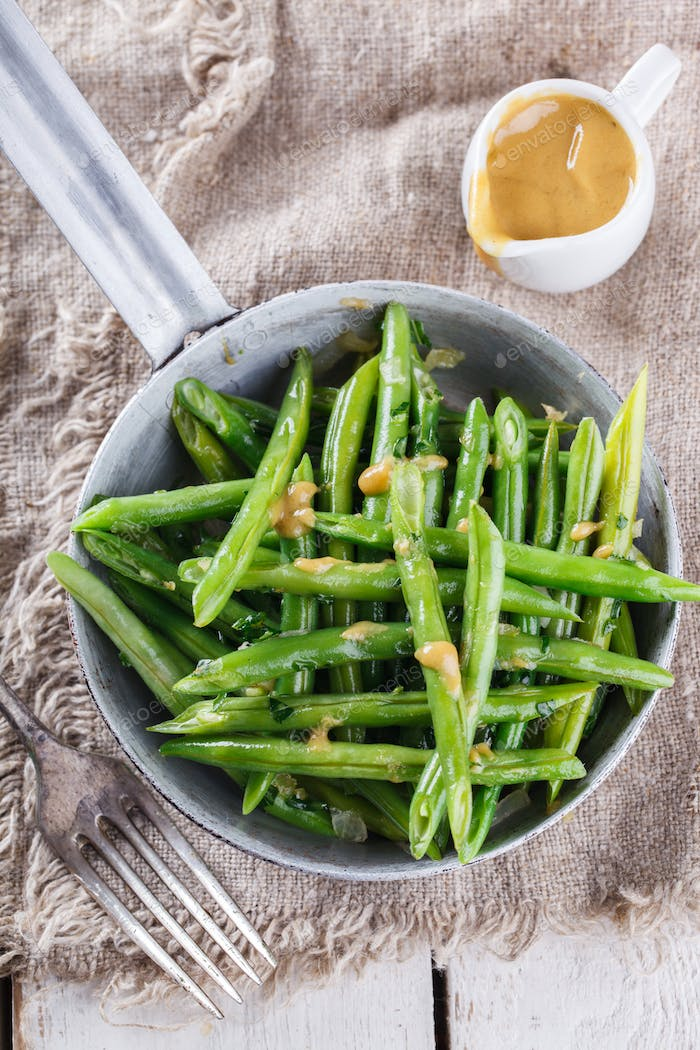 Salad with green beans and mustard sauce.