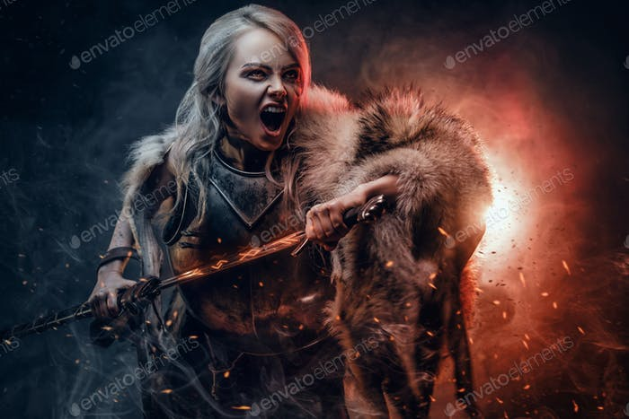 Fantasy woman wearing cuirass and fur, holding a sword and rushes into battle with a furious cry