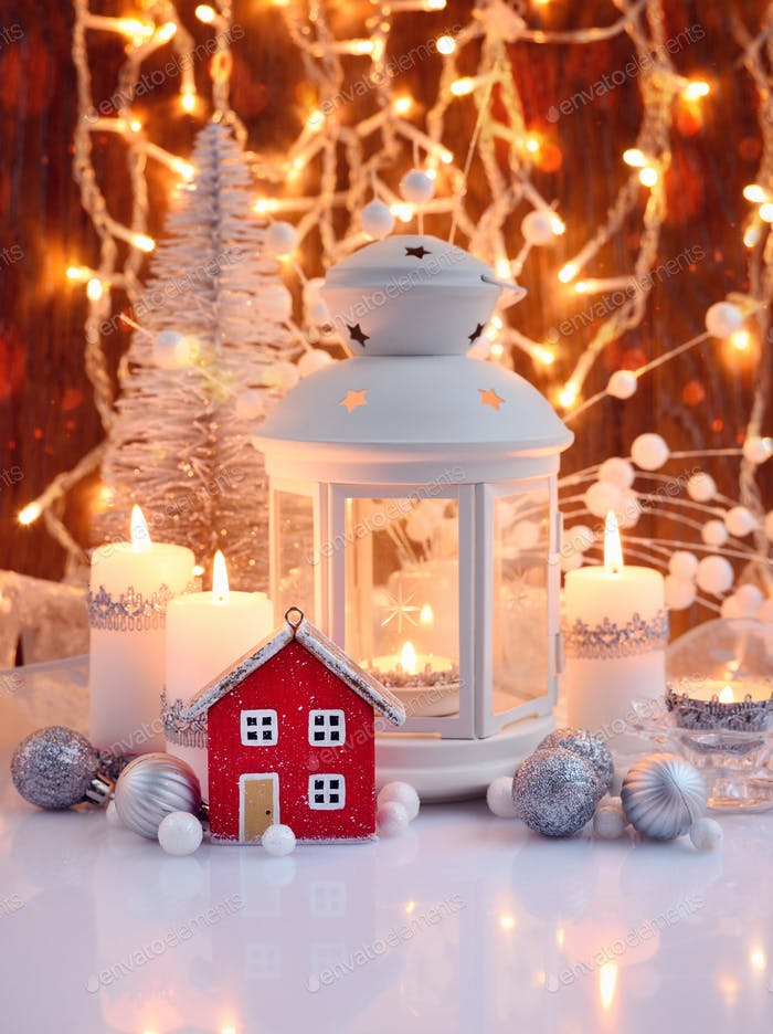 Christmas composition with lantern, candles and festive decorations