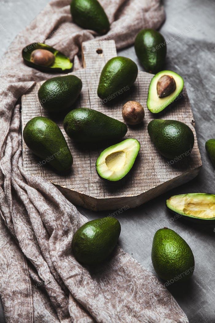 Avocado. Healthy food on the table. Rustic board