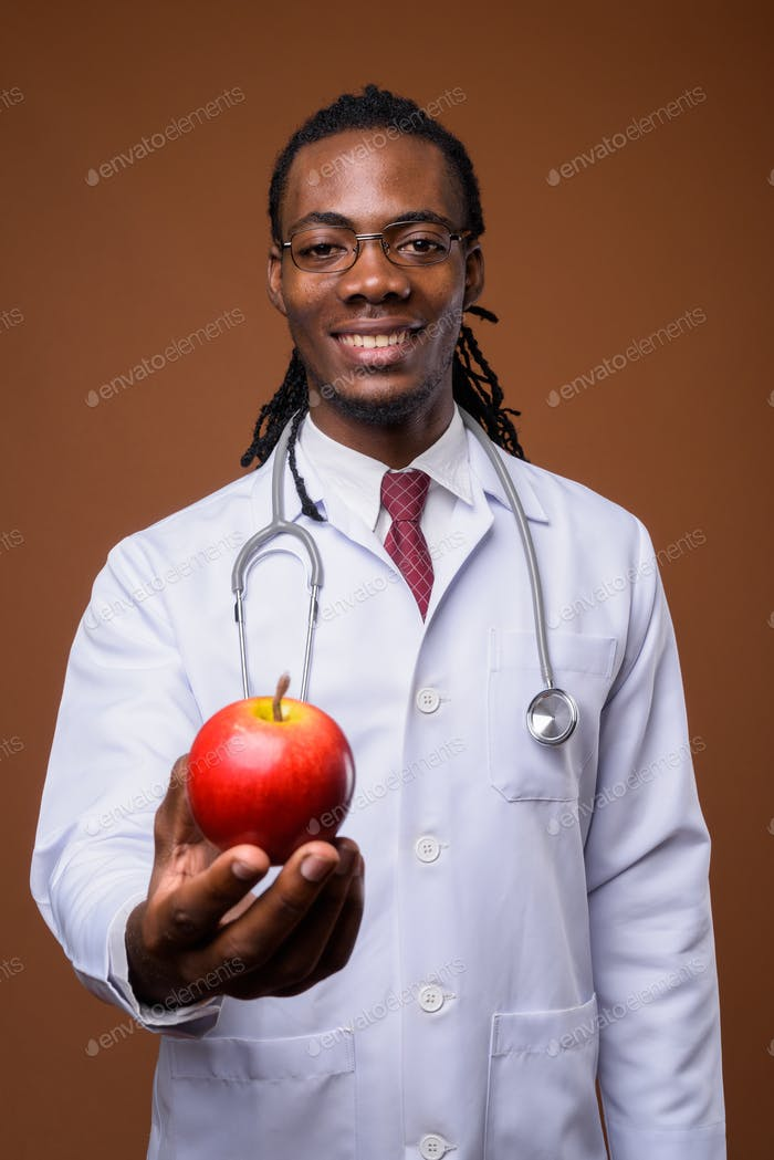 Young handsome African man doctor against brown background