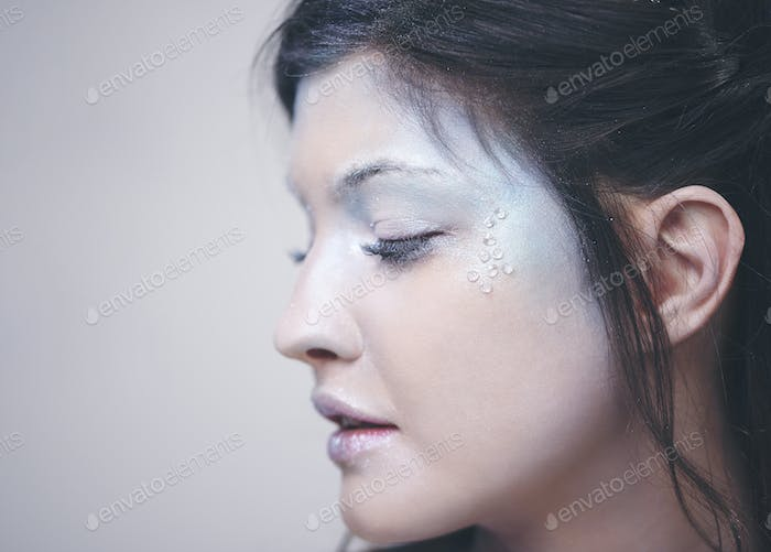 Human face in frosty makeup