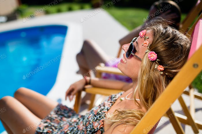 Women relaxing and sunbathing