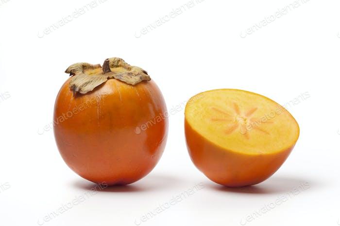 Whole and half Khaki fruit