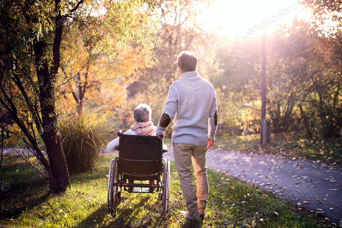Thumbnail for Senior man and woman in wheelchair in autumn nature.