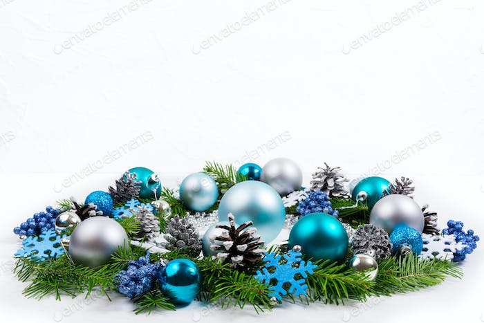 Christmas silver, blue, turquoise baubles wreath, copy space.