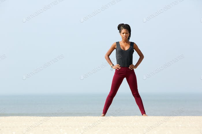 Young woman exercising at the beach