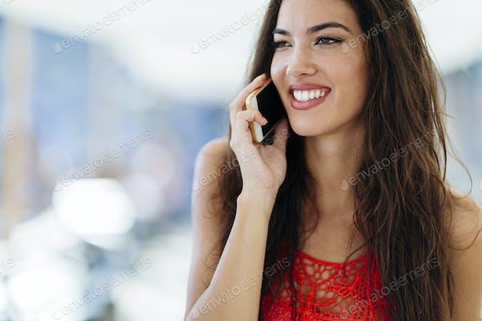 Beautiful model calling on phone