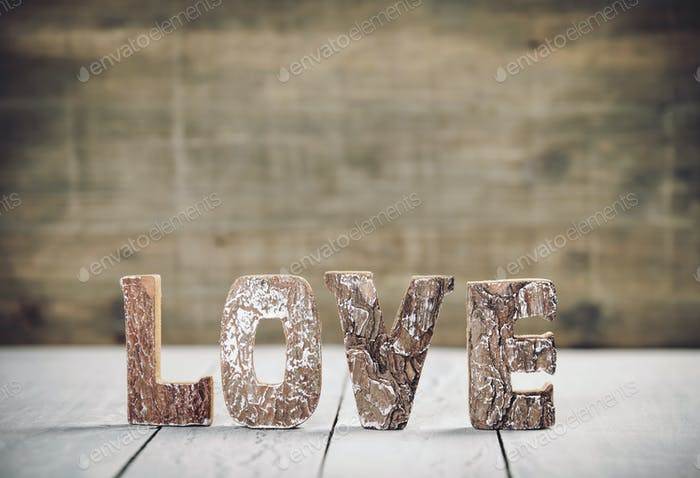 Valentine's Day concept. Love wood letters on table. Love wood letters close up.