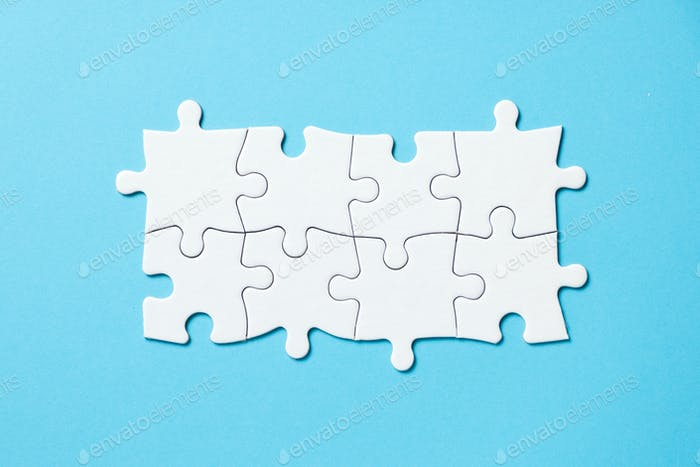 Eight pieces white jigsaw puzzle on blue background for business presentation