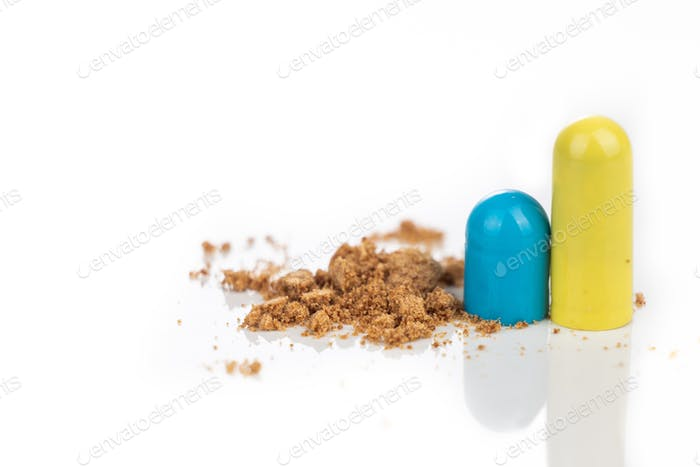 Close-up of opened medicine capsule revealing powder active drugs ingredients