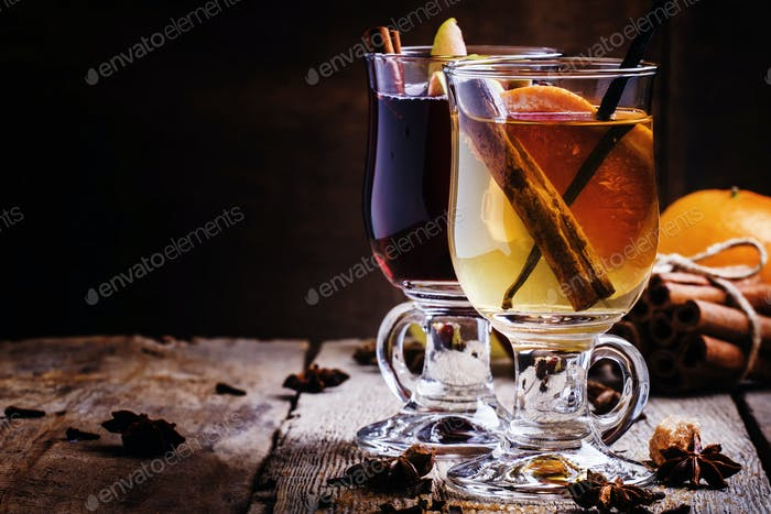 Hot mulled wine with white and red dry wine, spices and fruits