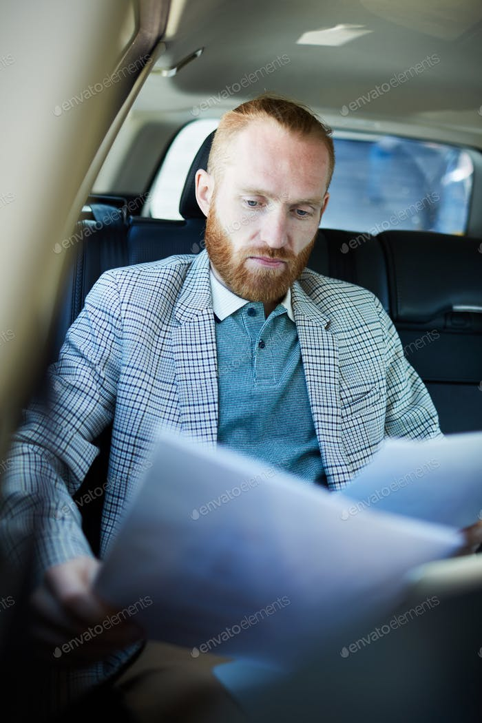 Busy man working inside of car