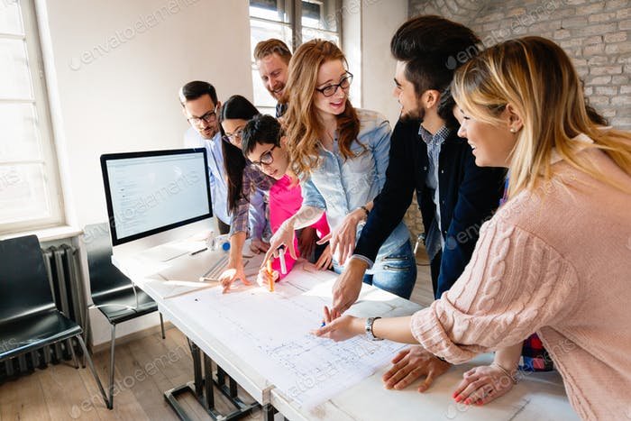Group of architects working on project in modern office