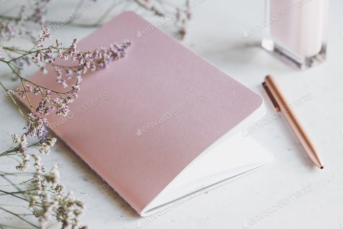 Pink empty paper notebook