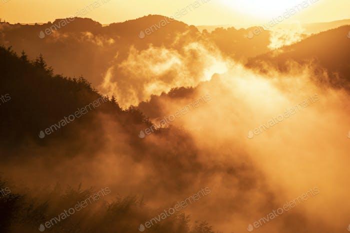 Magic foggy sunset in transylvaninan mountains.