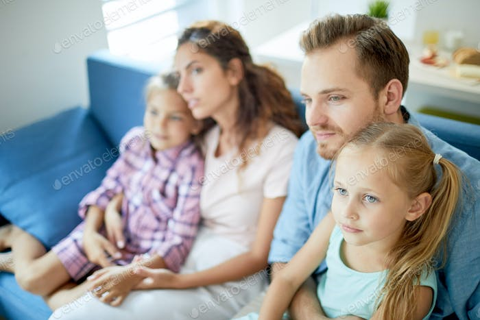Family in front of tv set