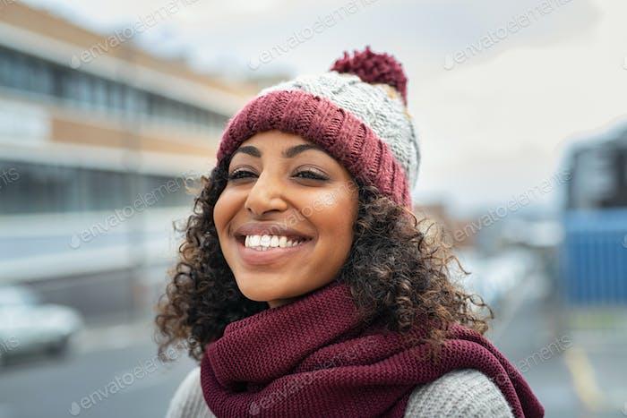 African woman wearing wool cap on winter