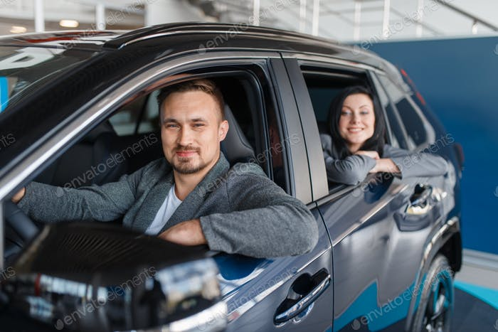 Couple buying new car, departure from the salon