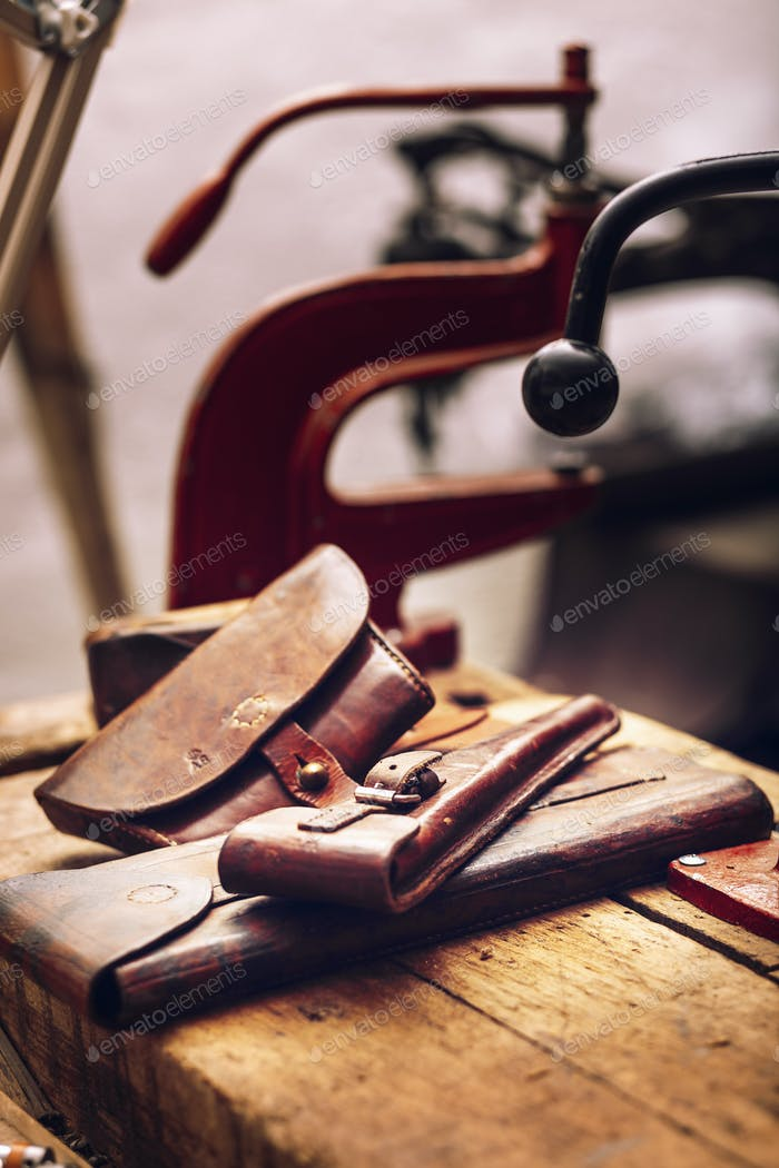 Leather pouches on table at workshop