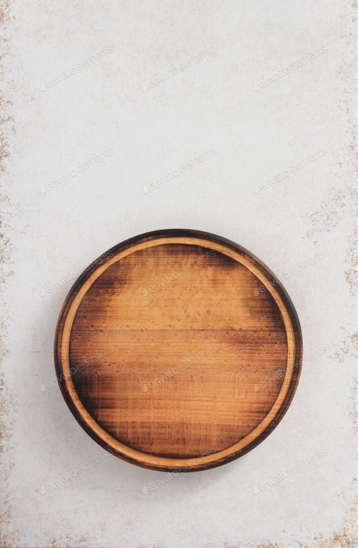 round cutting board at abstract background