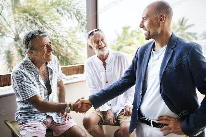Male seniors shaking hands