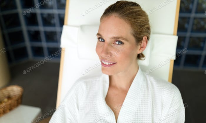 Beautiful woman relaxing in bathrobe in resort