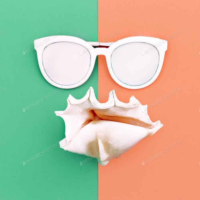 vacation time. Sea style. Shell and sunglasses Minimal art fashi