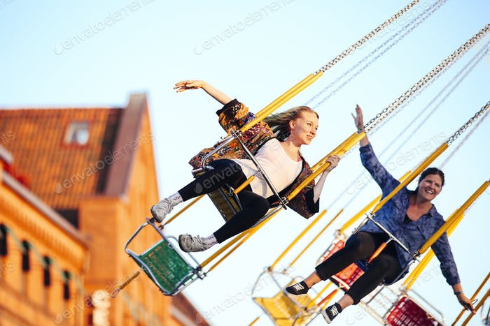 Young woman on fairground ride.