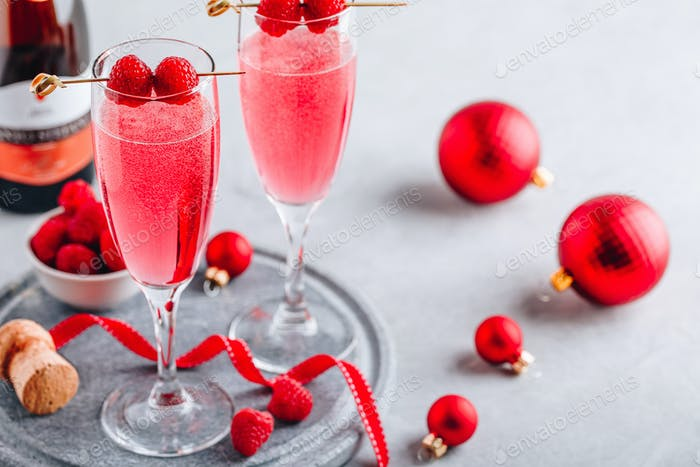 Pink Raspberry Mimosa Cocktail with champagne or prosecco