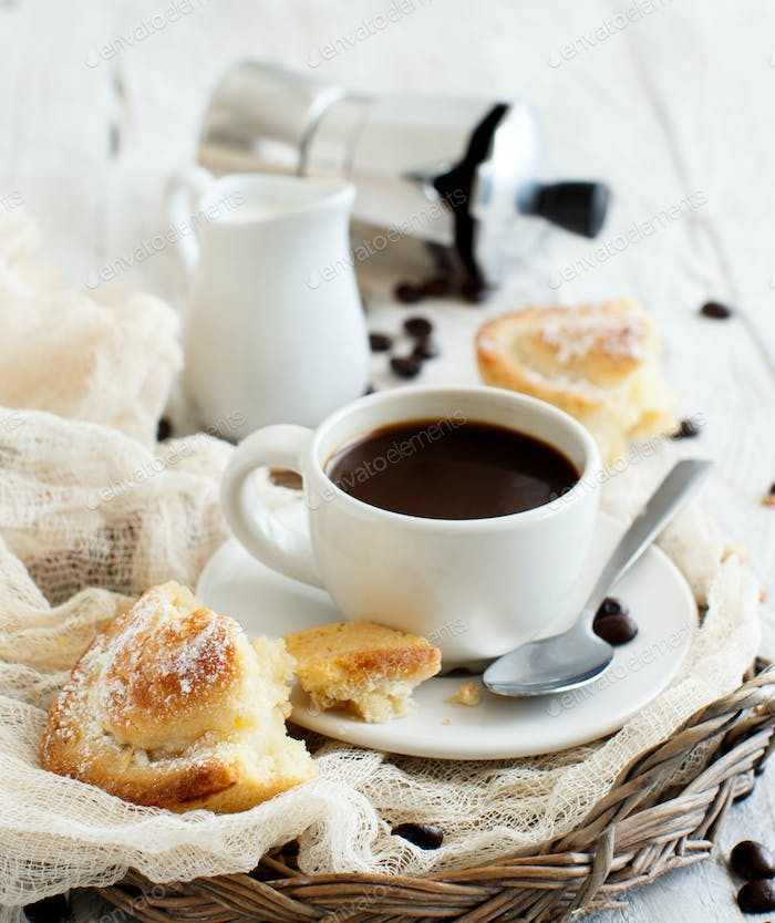 Thumbnail for Cup of coffee with pasticciotto pastry on a rustic background close up