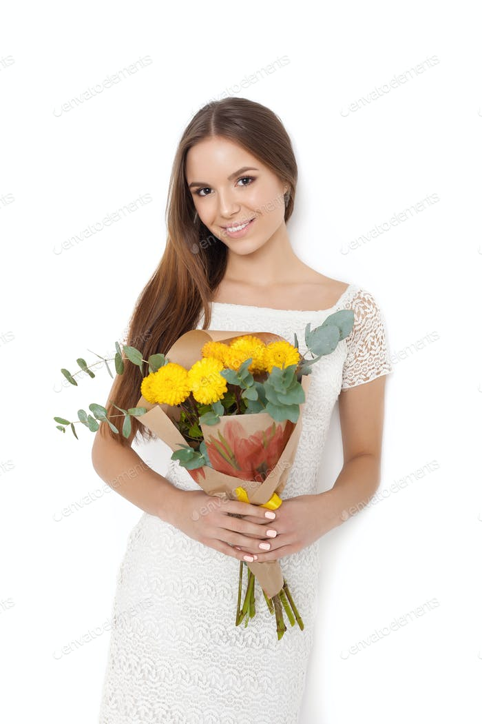 Young cute woman holding Bouquet of flowers