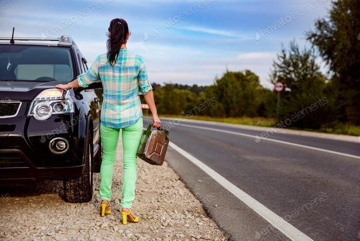 Woman with an empty tank of gas