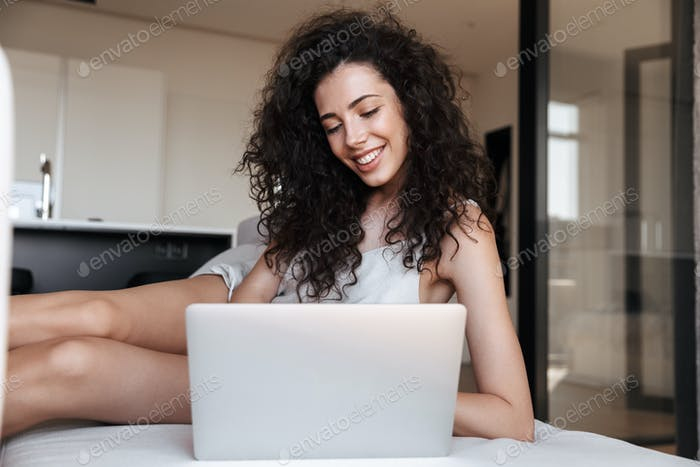 Caucasian adorable woman with long curly hair wearing silk leisu
