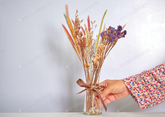 The dry flower arranged in the vase